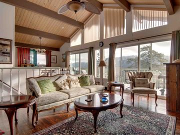 Lake Arrowhead cabin rental - The living/great room has vintage hardwood floors and great views.