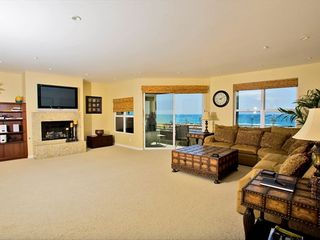 Spacious living room, large flat plasma TV. Balcony with Ocean View. 2nd floor - Carlsbad house vacation rental photo