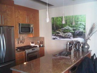 Calgary condo photo - full kitchen with expresso machine and professional tools