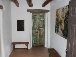 Las Cruces bungalow photo - Entrance way with old Mexican doors and original ceiling vigas.