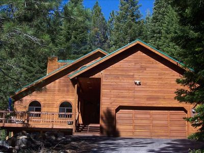 Tahoe cabin with sunny front deck in a lodgepole pine setting.