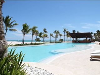 Punta Cana condo photo - One of two infinity pools and jacuzzis