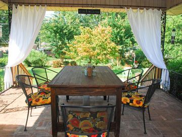 Tuscaloosa house rental - Open air covered back porch overlooking the garden.