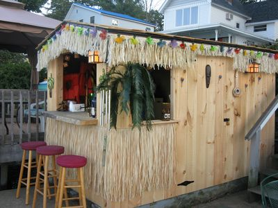 Tiki Hut/changing room on the water front patio, with small refrigerator inside