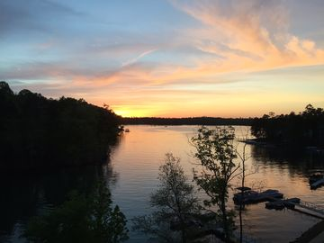 Lake Martin condo rental - The beautiful sunset off our balcony! Doesn't get any better!!!!