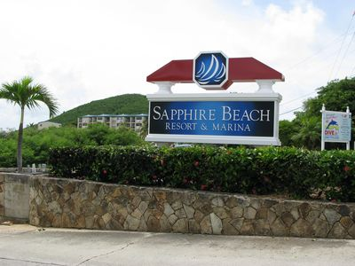Sign to Sapphire Beach with Sapphire Village in background