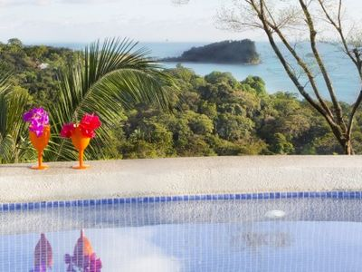 Villa Perezoso pool deck; Manuel Antonio National Park, the Pacific and wildlife