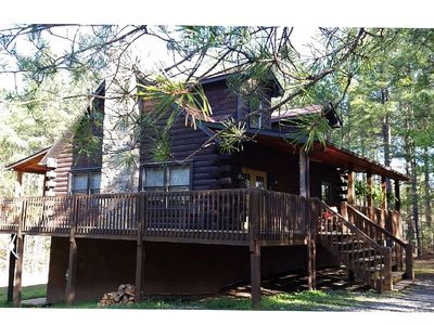 Large 3 level log cabin,  private on over 4 acres w/ handmade log swing on porch