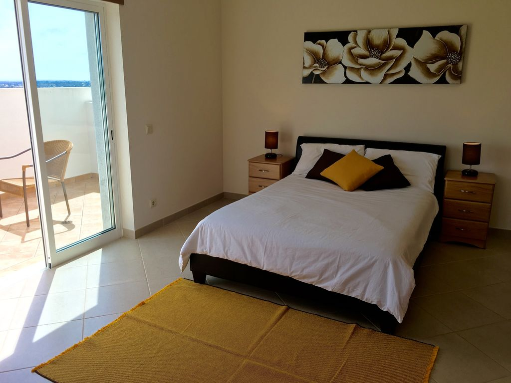 Santo Estêvão villa rental - Main bedroom with balcony, ensuite couples bathroom and ample storage space