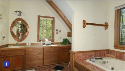 Spacious MBR bath features jetted tub, separate shower/toilet room, laundry room