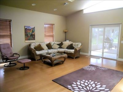 Family room with flat screen TV & access to lanai