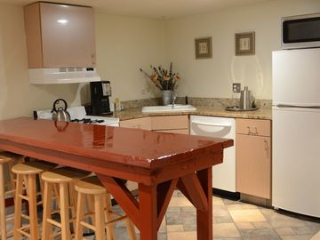Capitol Hill apartment rental - Full kitchen with stove, DW, refrigerator and microwave.