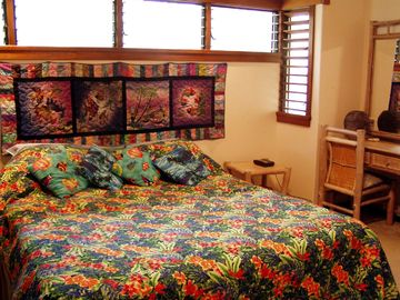 Master bedroom w/ king & hand made Hawaiian quilts