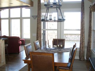 Lake Toxaway house photo - Dining room table sits six with elegant light above.