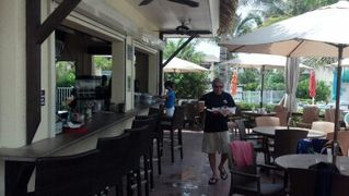 Hutchinson Island condo photo - Main pool side Tiki bar with food service !