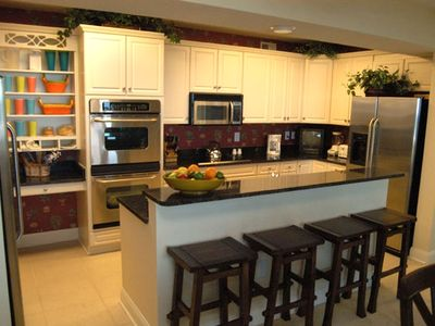 gourmet kitchen with granite countertops and Island