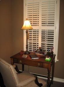 Antique Desk with Upholstered Desk Chair in Front Bedroom Nook