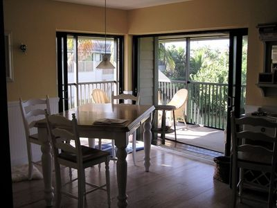 Dining area with rap around screened in lanai