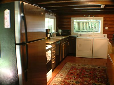 Kitchen in our cabin rental, large screened in porch right off the kitchen