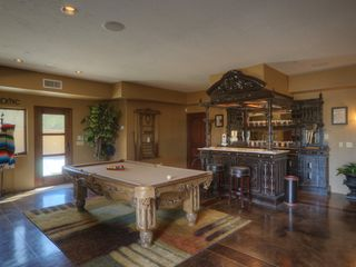 Scottsdale house photo - custom bar and tool table in entertaining & living area