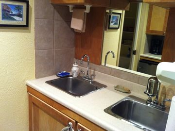 Stainless steel sinks and large mirrors.