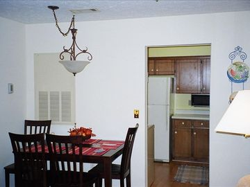 Full service kitchen, laminate flooring, dining nook.