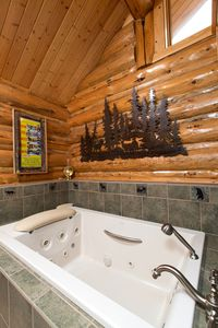 Master bath tub has plenty of room to wash 2 adults or a pool for a herd of kids
