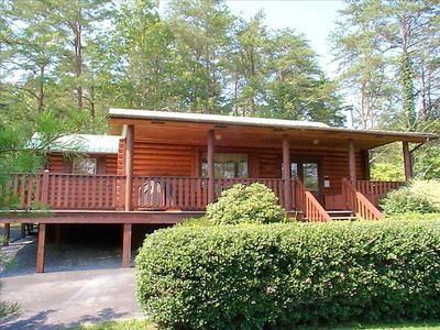 Real log cabin with large wrap around deck w/ gas grill, rockers and hot-tub.