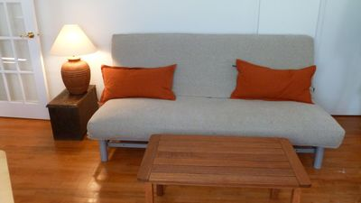 Full-sized futon in living area.