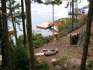 Orrs Island cottage photo - Gun Point Cove from deck w dock, float & fire pit
