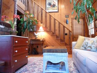 Stairs from Living Room toTV/Library loft & cute BR with 3 twin beds - Kennebunk house vacation rental photo
