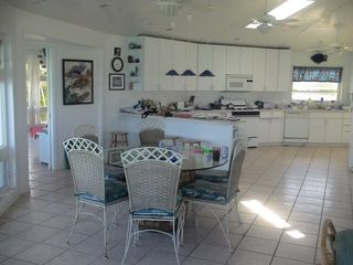Elbow Cay and Hope Town villa photo - Expansive, open kitchen and dining area. Note skylight and ceiling fans.