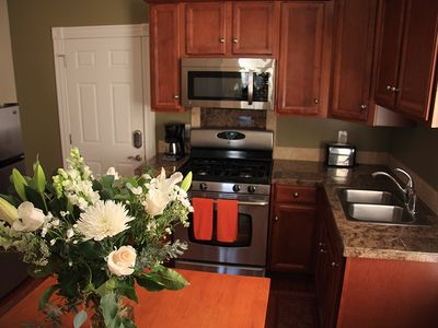Fully Equipped Kitchen, Stainless Appliances and Granite Countertops.