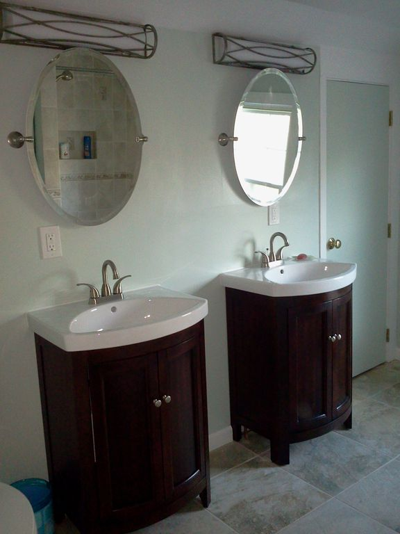 Brand new bathroom with double vanities and tiled shower.