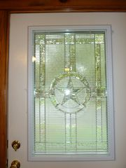 Austin cottage photo - Front Door: Beautiful glass window with the Texas State Star, w mini-blinds
