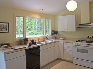 bright sunny eat in kitchen with views from the sink! - Great Barrington property vacation rental photo