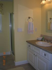 Downstairs bathroom with shower & washer & dryer