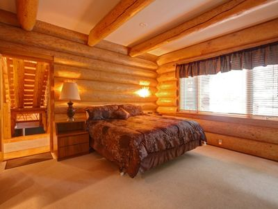 King master bedroom with great lake views and exterior access to deck.