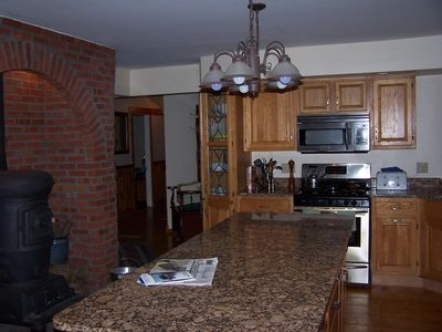 Kitchen island seats 8 (laundry room to left of pot-bellied stove arch)