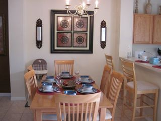 Emerald Island townhome photo - Dinning table for 6 persons and breakfast bar. Plus baby high chair available