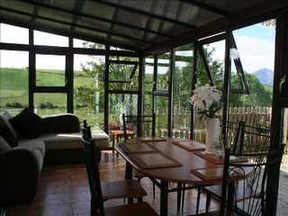 County Mayo cottage photo - Conservatory and summer dining area with views of the surrounding are