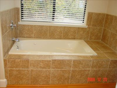 Jetted tub in spacious master bathroom
