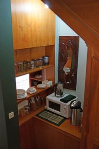 Full kitchenette in Riveview Suite with microwave, blender, refrigerator