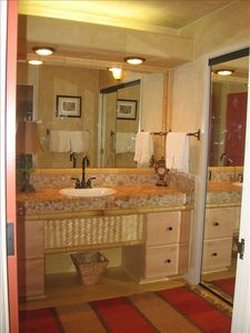 Dressing Room, Bamboo flooring, Polished Hawaiian River Rock Vanity.