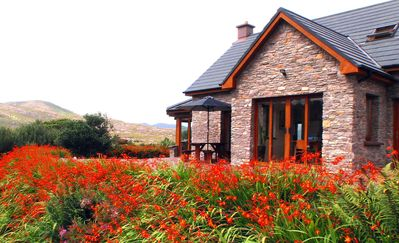 Luxury Home in exclusive Oysterbed with spectacular sea & mountain views. WiFi.