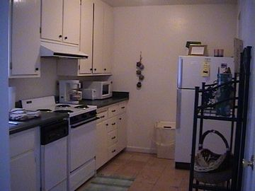 Kitchen w/dishwasher, microwave, utensils included, laundry room to the right