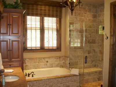 Boone house rental - The well appointed Master Bathroom with Travertine Stone throughout