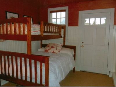 Bunk bed with a double bed and single on top.