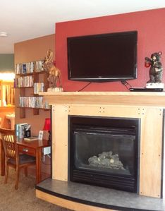 Fireplace with large flat panel tv above the mantel.