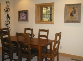 Enjoy Family Meals Within Site of Cozy Fireplace